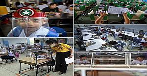 Fotoğraflar 1 Temmuz 2020'de eğitim öğretimin devam ettiği Tayland Sam Khok Ortaokulunda çekilmiş.